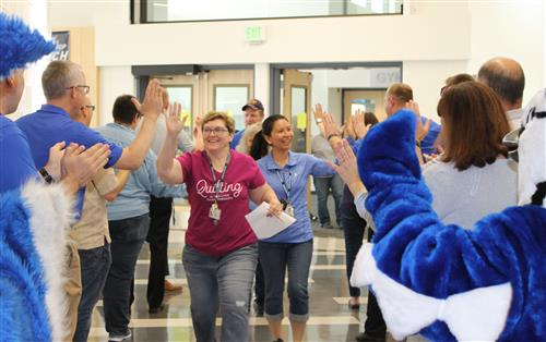 Staff high fiving at end of year celebration
